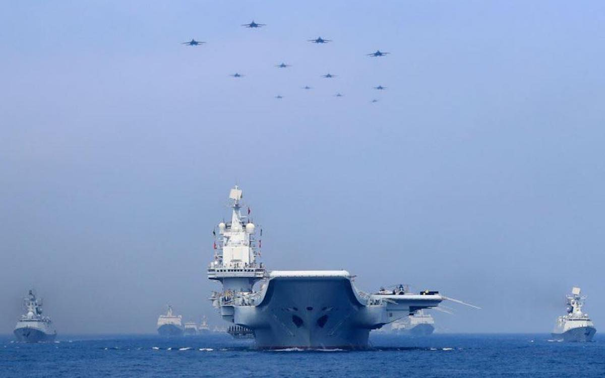 The image shows a Chinese carrier group on exercises. China's PLA Navy would spearhead the invasion of Taiwan.
