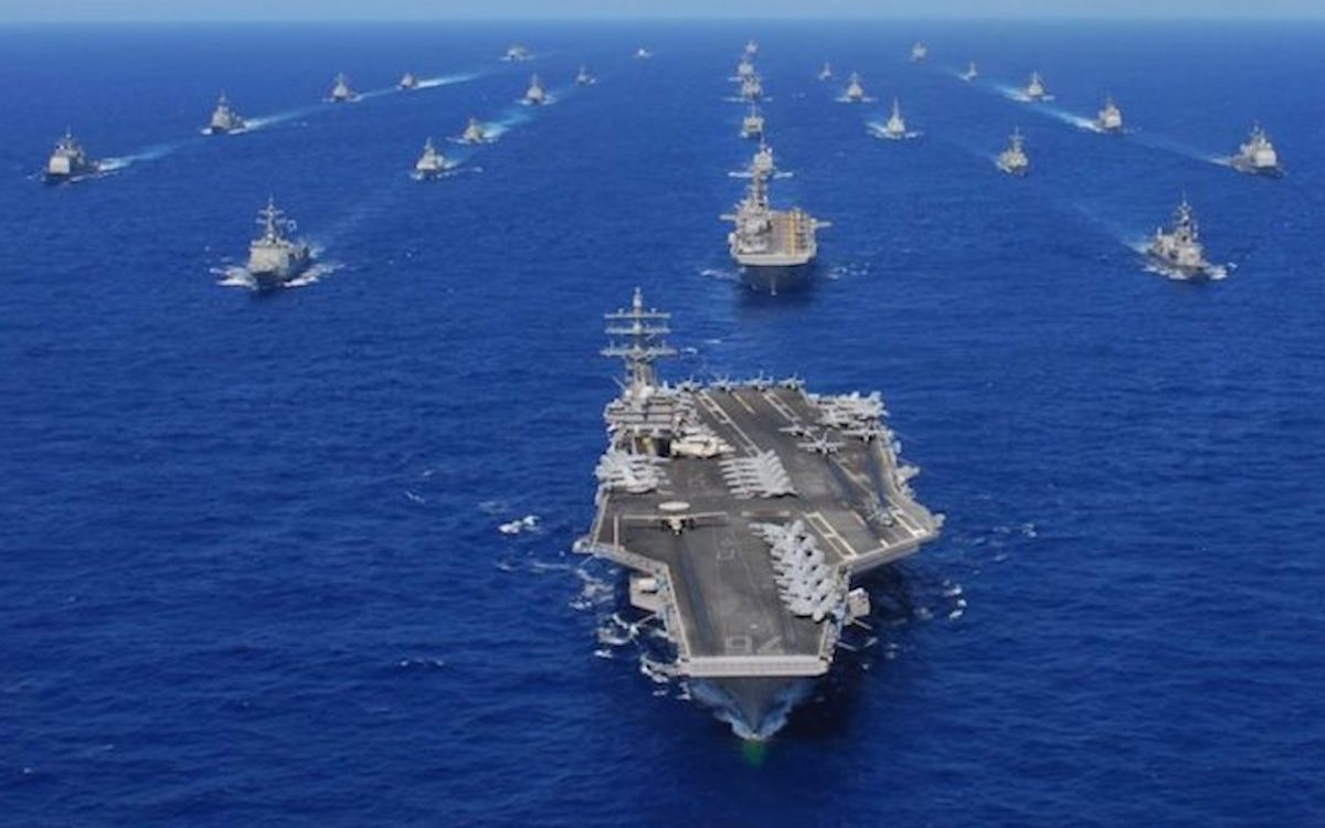 The image shows a US Navy carrier strike group at sea. Beijing has denounced drills by the United States Navy in the highly-contentious South China Sea.