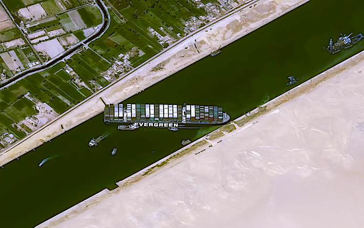 The satellite image shows the sheer size of the Ever Given container ship blocking access to a section of the Suez Canal. The logjam will affect China's exports to Europe.