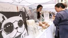 volunteers-with-artwork