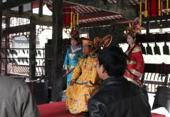 Chinese people dress in traditional costumes at a park in Chengdu.