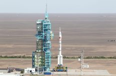 The CZ-2F / Shenzhou launch vehicle stack at Pad 921, hours before the liftoff. The rotating platforms of the umbilical tower had swung back into the launch position