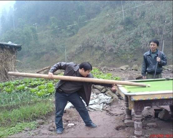 A Very Dedicated Pool Player In Rural China