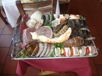 Before cooked; lobster, crab, clams and fish platter