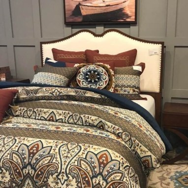 The right bedding can create a focal point in the bedroom.