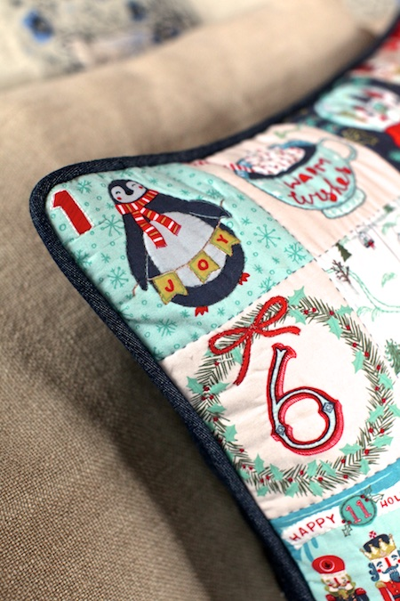 embroidered advent pillow