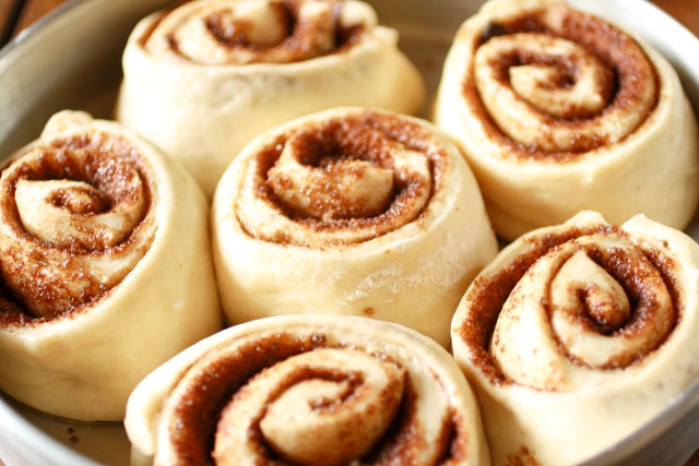 Homemade, Fluffy Cinnamon Rolls dough in a round pan
