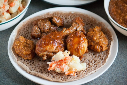plate with injera, lentils and beef
