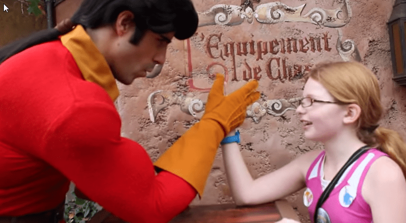 Girl challenges Gaston to arm wrestle match and wins!
