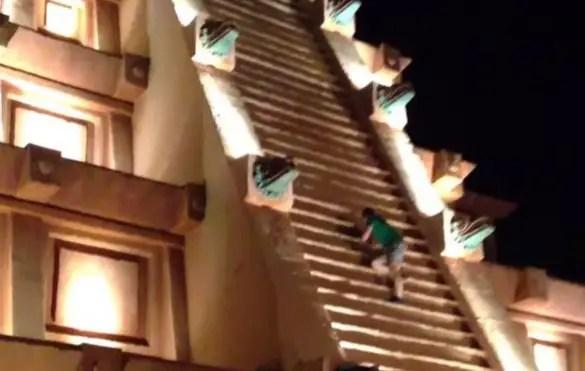 Drunk Man climbs pyramid at Epcot's Mexico Pavilion