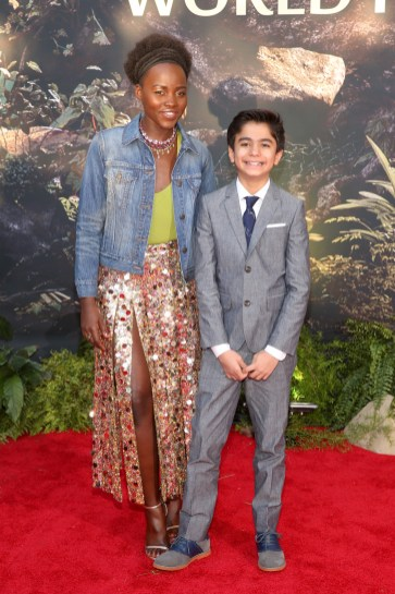"""HOLLYWOOD, CALIFORNIA - APRIL 04: Actors Lupita Nyong'o and Neel Sethi attend The World Premiere of Disney's """"THE JUNGLE BOOK"""" at the El Capitan Theatre on April 4, 2016 in Hollywood, California. (Photo by Jesse Grant/Getty Images for Disney) *** Local Caption *** Neel Sethi; Lupita Nyong'o"""