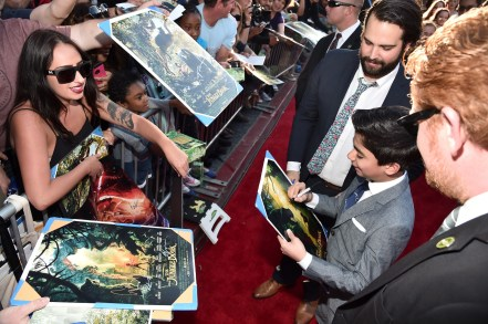"""HOLLYWOOD, CALIFORNIA - APRIL 04: Actor Neel Sethi signs autographs for fans at The World Premiere of Disney's """"THE JUNGLE BOOK"""" at the El Capitan Theatre on April 4, 2016 in Hollywood, California. (Photo by Alberto E. Rodriguez/Getty Images for Disney) *** Local Caption *** Neel Sethi"""