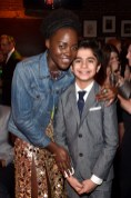 """HOLLYWOOD, CALIFORNIA - APRIL 04: Actors Lupita Nyong'o (L) and Neel Sethi attend The World Premiere of Disney's """"THE JUNGLE BOOK"""" at the El Capitan Theatre on April 4, 2016 in Hollywood, California. (Photo by Alberto E. Rodriguez/Getty Images for Disney) *** Local Caption *** Neel Sethi; Lupita Nyong'o"""
