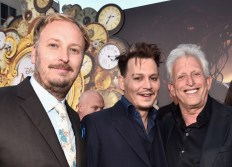 HOLLYWOOD, CA - MAY 23: (L-R) Director James Bobin, actor Johnny Depp and producer Joe Roth attend Disney's 'Alice Through the Looking Glass' premiere with the cast of the film, which included Johnny Depp, Anne Hathaway, Mia Wasikowska and Sacha Baron Cohen at the El Capitan Theatre on May 23, 2016 in Hollywood, California. (Photo by Alberto E. Rodriguez/Getty Images for Disney) *** Local Caption *** James Bobin; Johnny Depp; Joe Roth