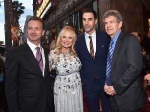 HOLLYWOOD, CA - MAY 23: (L-R) President of Walt Disney Studios Motion Picture Production Sean Bailey, producer Suzanne Todd, actor Sacha Baron Cohen and chairman of the Walt Disney Studios Alan Horn attend Disney's 'Alice Through the Looking Glass' premiere with the cast of the film, which included Johnny Depp, Anne Hathaway, Mia Wasikowska and Sacha Baron Cohen at the El Capitan Theatre on May 23, 2016 in Hollywood, California. (Photo by Alberto E. Rodriguez/Getty Images for Disney) *** Local Caption *** Sean Bailey; Suzanne Todd; Sacha Baron Cohen; Alan Horn