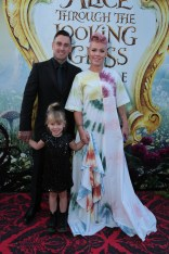 """Carey Hart, Willow Sage Hart and Pink pose together at The US Premiere of Disney's """"Alice Through the Looking Glass"""" at the El Capitan Theater in Los Angeles, CA on Monday, May 23, 2016. .(Photo: Alex J. Berliner/ABImages)"""