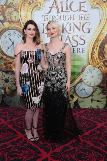 """Anne Hathaway and Mia Wasikowska pose together at The US Premiere of Disney's """"Alice Through the Looking Glass"""" at the El Capitan Theater in Los Angeles, CA on Monday, May 23, 2016. .(Photo: Alex J. Berliner/ABImages)"""