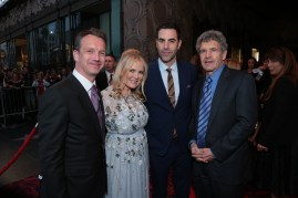 """Shawn Bailey, Suzanne Todd, Sacha Baron Cohen, Alan Horn pose together at The US Premiere of Disney's """"Alice Through the Looking Glass"""" at the El Capitan Theater in Los Angeles, CA on Monday, May 23, 2016. .(Photo: Alex J. Berliner/ABImages)"""