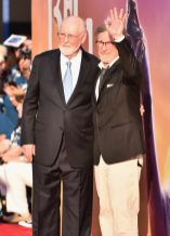 """HOLLYWOOD, CA - JUNE 21: Composer John Williams (L) and director Steven Spielberg arrive on the red carpet for the US premiere of Disney's """"The BFG,"""" directed and produced by Steven Spielberg. A giant sized crowd lined the streets of Hollywood Boulevard to see stars arrive at the El Capitan Theatre. """"The BFG"""" opens in U.S. theaters on July 1, 2016, the year that marks the 100th anniversary of Dahl's birth, at the El Capitan Theatre on June 21, 2016 in Hollywood, California. (Photo by Alberto E. Rodriguez/Getty Images for Disney) *** Local Caption *** John Williams; Steven Spielberg"""