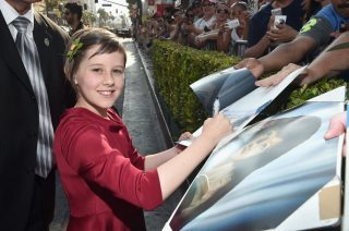 """HOLLYWOOD, CA - JUNE 21: Actress Ruby Barnhill arrives on the red carpet for the US premiere of Disney's """"The BFG,"""" directed and produced by Steven Spielberg. A giant sized crowd lined the streets of Hollywood Boulevard to see stars arrive at the El Capitan Theatre. """"The BFG"""" opens in U.S. theaters on July 1, 2016, the year that marks the 100th anniversary of Dahl's birth, at the El Capitan Theatre on June 21, 2016 in Hollywood, California. (Photo by Alberto E. Rodriguez/Getty Images for Disney) *** Local Caption *** Ruby Barnhill"""
