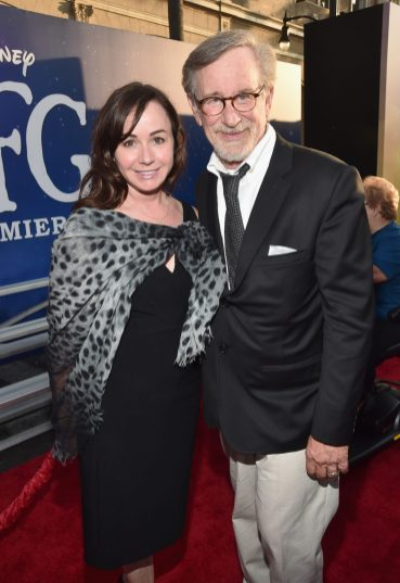 """HOLLYWOOD, CA - JUNE 21: Executive producer Kristie Macosko Krieger (L) and Director Steven Spielberg arrive on the red carpet for the US premiere of Disney's """"The BFG,"""" directed and produced by Steven Spielberg. A giant sized crowd lined the streets of Hollywood Boulevard to see stars arrive at the El Capitan Theatre. """"The BFG"""" opens in U.S. theaters on July 1, 2016, the year that marks the 100th anniversary of Dahl's birth, at the El Capitan Theatre on June 21, 2016 in Hollywood, California. (Photo by Alberto E. Rodriguez/Getty Images for Disney) *** Local Caption *** Kristie Macosko Krieger; Steven Spielberg"""