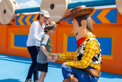 Gloria Estefan watches as her grandson, Sasha, shares a special moment with Woody, Sunday, June 24, 2018, while previewing Toy Story Land at Disney's Hollywood Studios in Lake Buena Vista, Fla. In the new land, officially open on June 30, Walt Disney World Resort guests can whoosh along on the family-friendly roller coaster Slinky Dog Dash, take a spin aboard Alien Swirling Saucers and try for the high score on Toy Story Mania! (Steven Diaz, photographer)