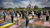 2018-06-21 16_37_43-Thousands Celebrate International Yoga Day at Iconic Disney Parks Locations _ Di