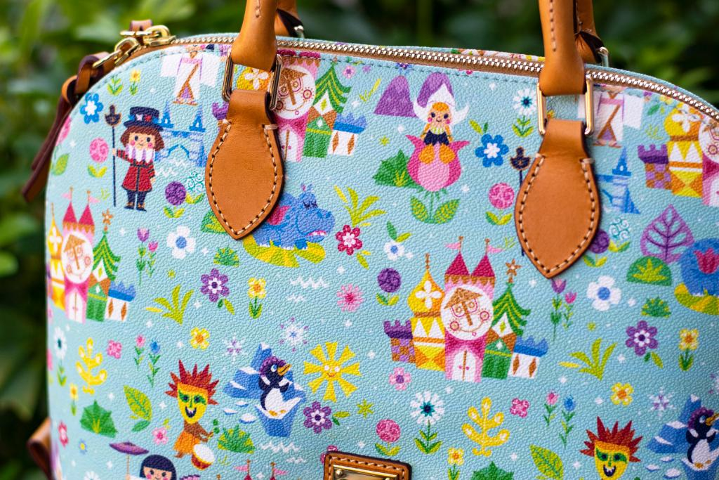New it's a small world Dooney and Bourke Collection Now Available
