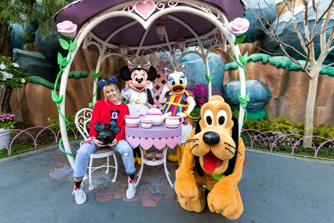 Miley Cyrus Visits Disneyland During Get Your Ears On – A Mickey and Minnie Celebration