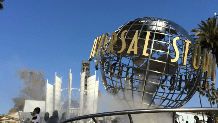 Universal Studios Hollywood; Climate Activists Climb, Superglue Themselves to The Globe