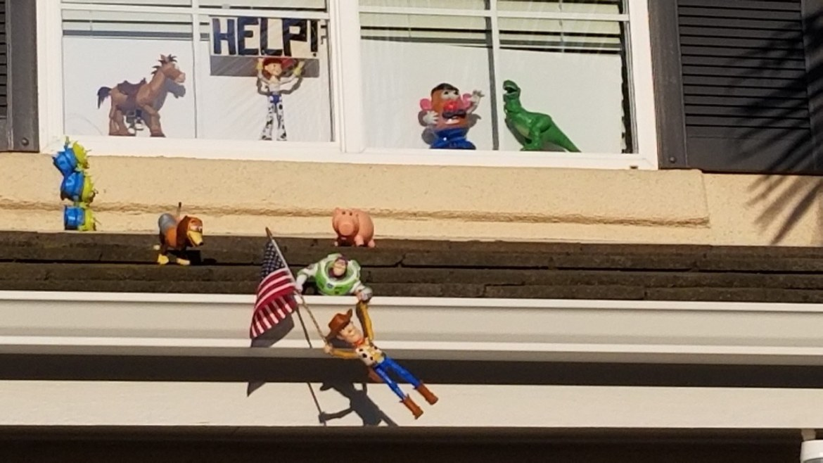 Couple uses Toy Story Characters to bring joy to Neighbors