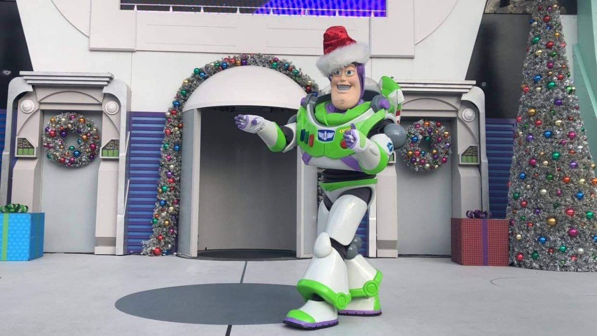 Jingle Buzz greeting guests in Tomorrowland in the Magic Kingdom