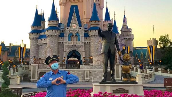Cast Member in front of Cinderella Castle