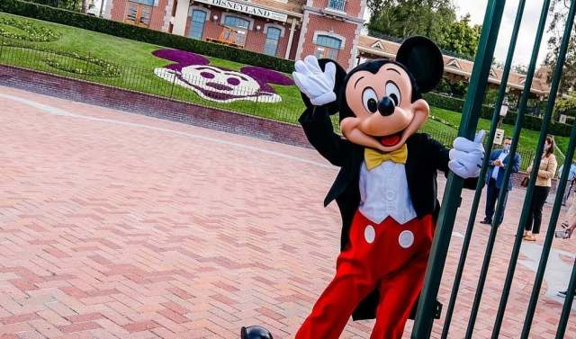 Mickey Mouse opens the gates and welcome guests back to Disneyland 2