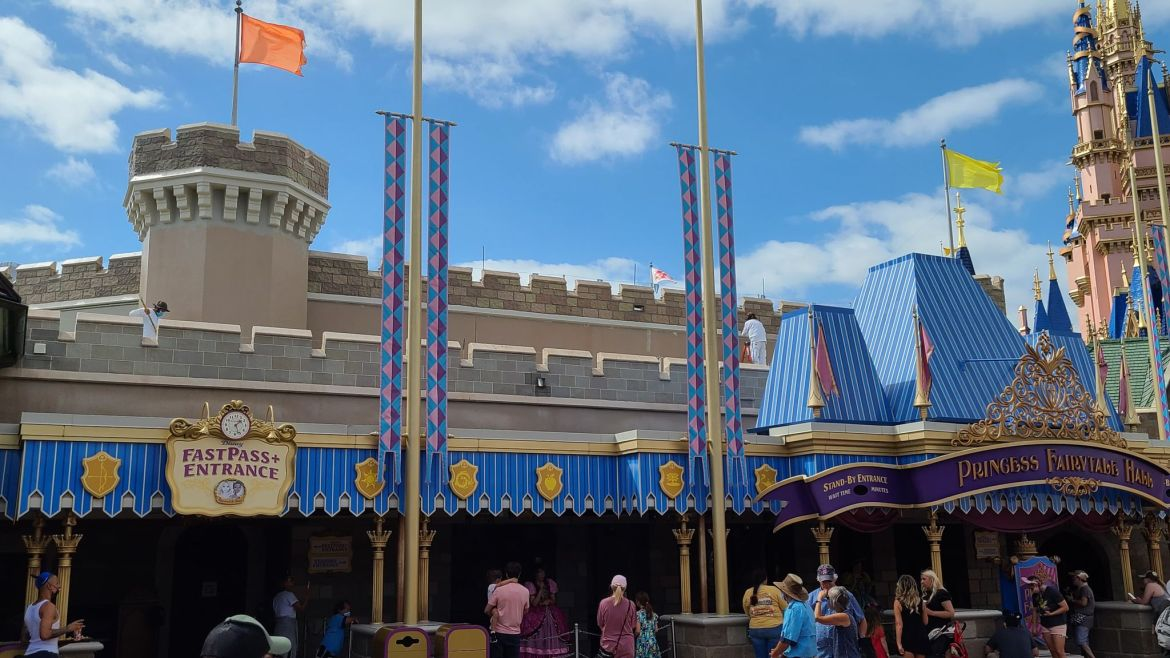 Painting continues of the roofs in Fantasyland to prepare for Disney World's 50th