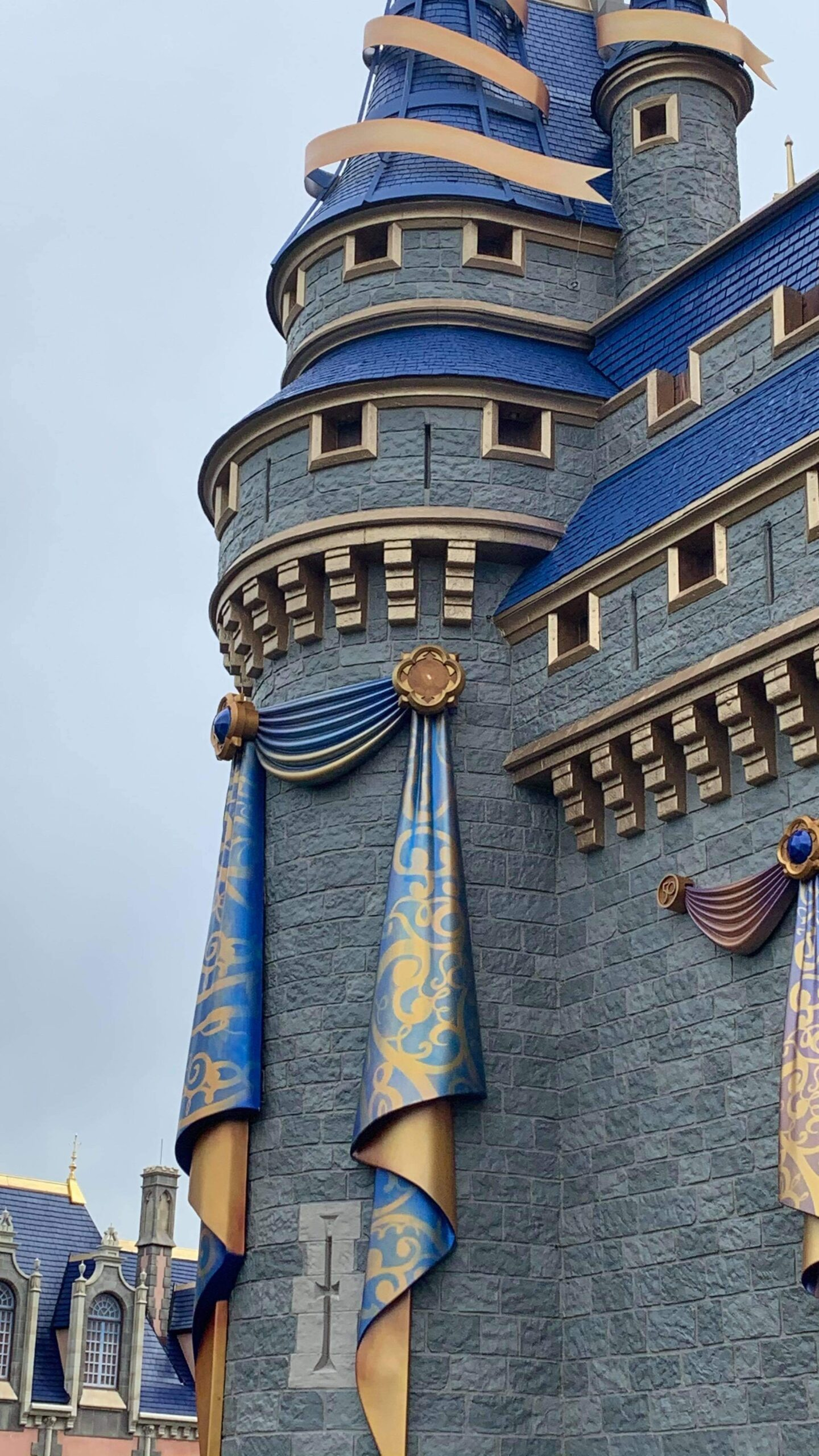 One of the 50th anniversary Cinderella Castle decorations fall off 3