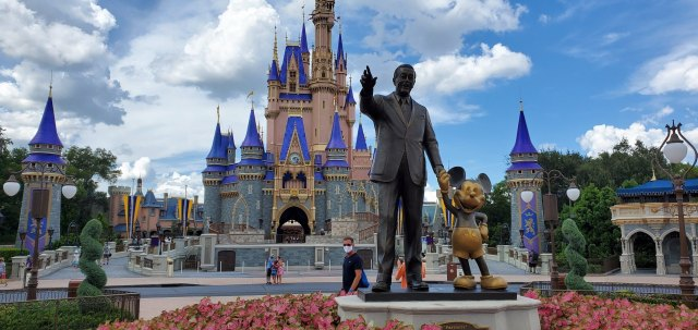 Walt Disney Statue in the Magic Kingdom is being refurbished for the 50th Anniversary 1