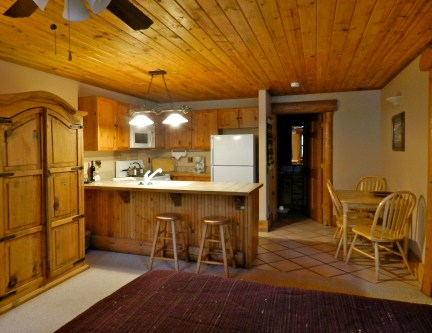 202 Studio A wooden style kitchen and dining area with a breakfast nook