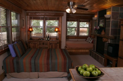 202 Studio An amazing bedroom with a fireplace and comfy wooden style