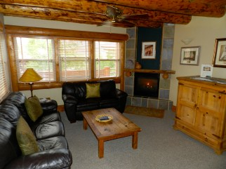 304 One Bedroom A chill living room with black leather sofa set. One Bedroom Spa Suites Colorado