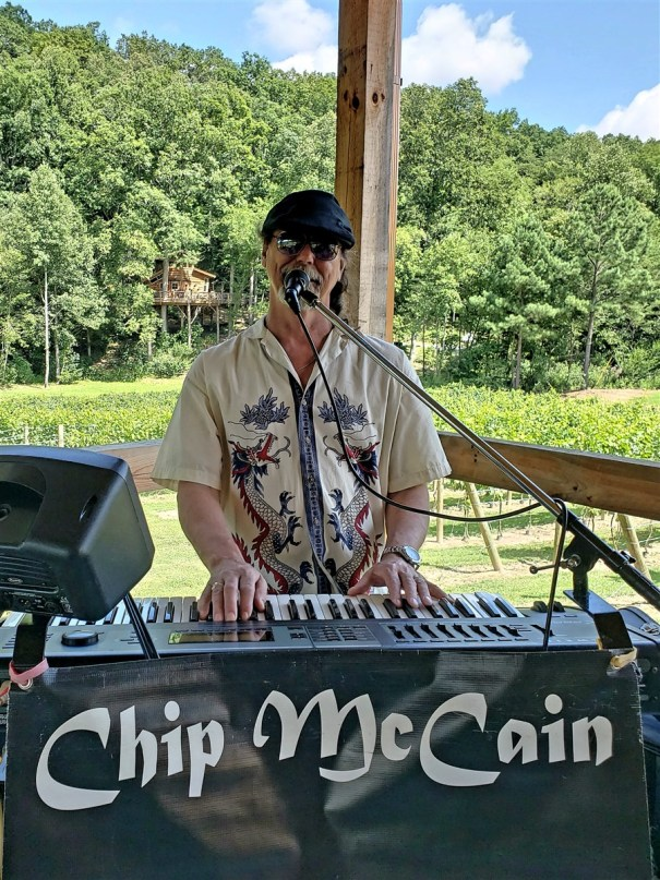 a photo of chip playing keyboards on the patio at bear claw vineyards in blue ridge georgia