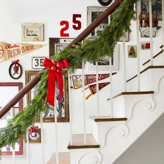 best staircase christmas decor ideas red bows jpg 1603124405 Christmas Decorating Ideas