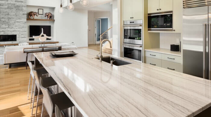 Quartzite countertops white macaubus kitchen island wood flooring cmprs bathroom countertop options