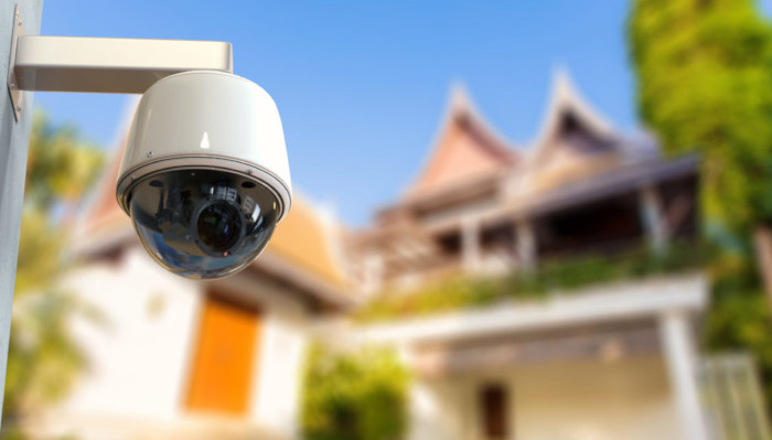 CCTV camera in front of house 700x400 flipped 4K security camera
