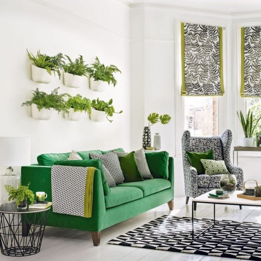Green Urban Jungle Living Room with Unique Pots Ways to Decorate Bare Walls