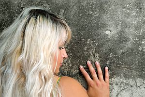 seductive blond and wall