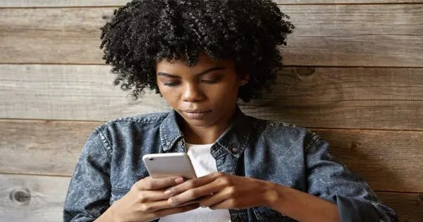blog picture of african woman using cell phone