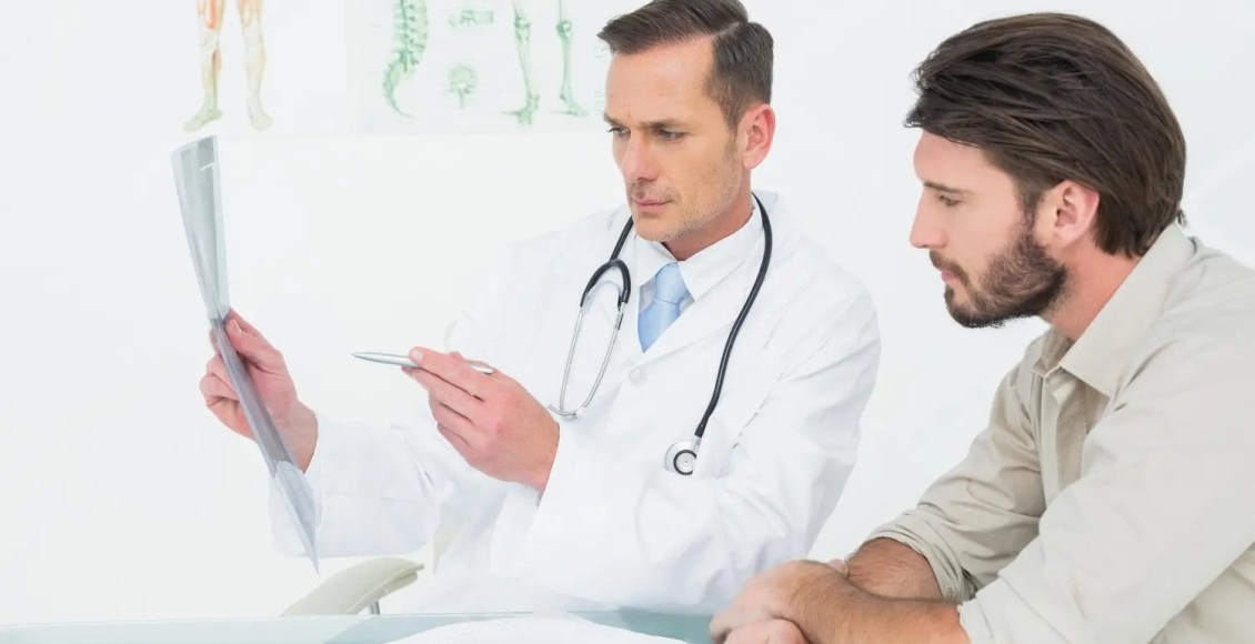 chiropractor talks with patient