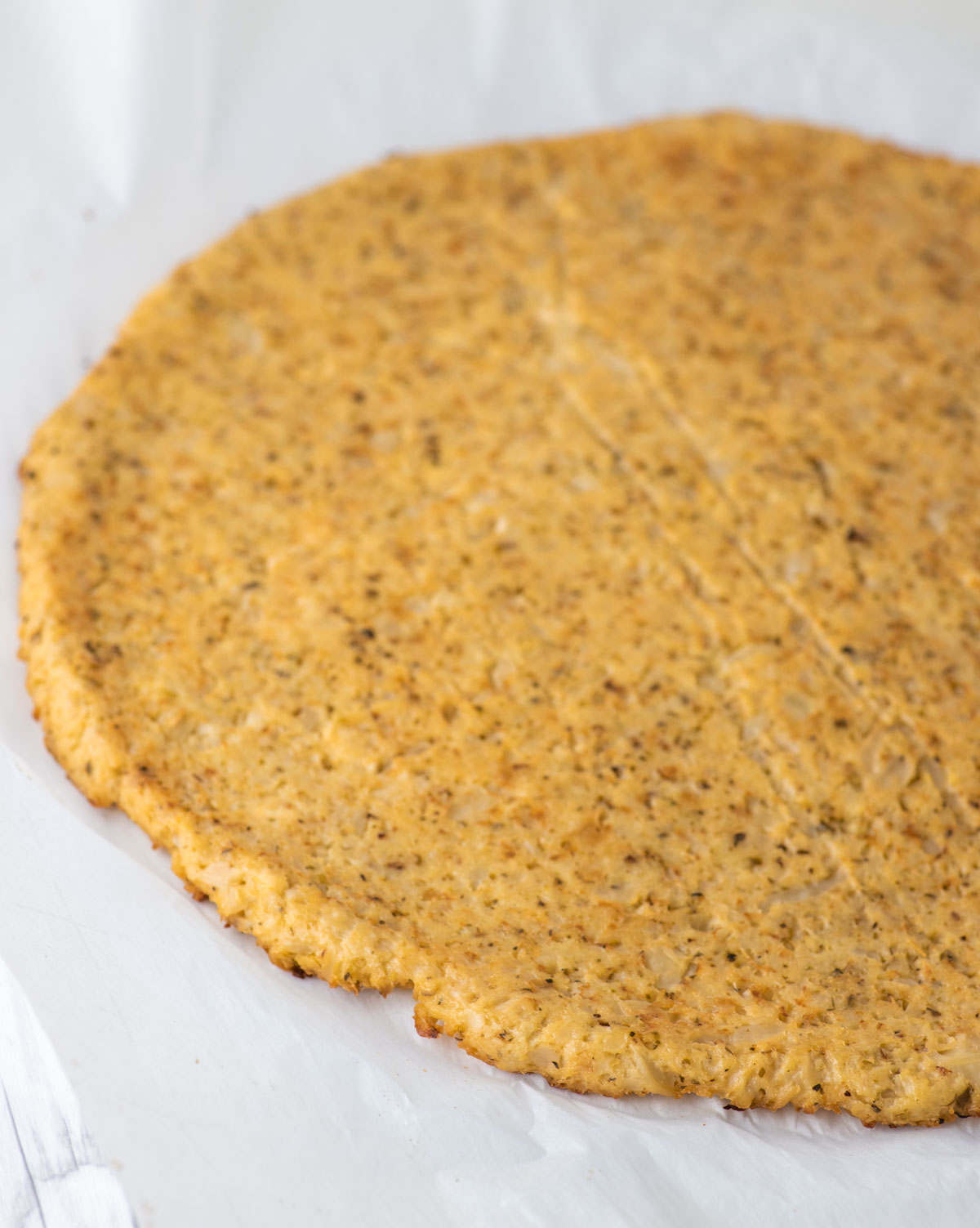 cauliflower crust on parchment paper