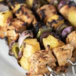 Hawaiian chicken kebabs on plate